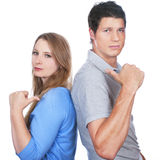 Young man and Woman with accusation. Young men and Woman pointing finger at each other isolated Royalty Free Stock Photography
