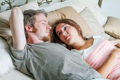 Young man and woman in bed. Royalty Free Stock Photography