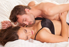 Young man and woman in bed Royalty Free Stock Photography