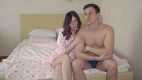 Young man and woman in the bedroom.  stock video footage