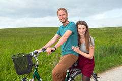 Young man and woman on bicycle Royalty Free Stock Photos