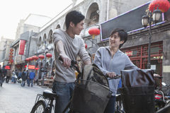 Young man and woman with bicycles and backpacks. Royalty Free Stock Photos