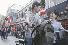 Young man and woman with bicycles and backpacks. Royalty Free Stock Photography