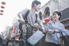 Young man and woman with bicycles and map. Stock Photo