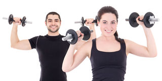 Young man and woman in black sportswear doing exercises with dum Royalty Free Stock Images