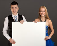 Young man and woman with blank board Stock Photo