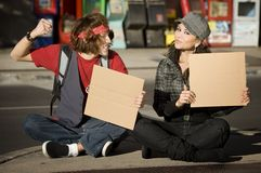Young Man and Woman with Blank Cardboard Signs Royalty Free Stock Image