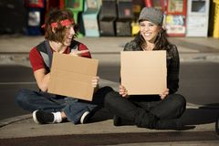 Young Man and Woman with Blank Cardboard Signs Royalty Free Stock Images