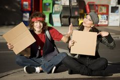 Young Man and Woman with Blank Cardboard Signs Royalty Free Stock Photos