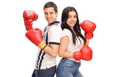 Young man and woman with boxing gloves Royalty Free Stock Photos