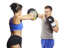 Young man and woman boxing sparring Stock Photography
