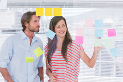 Young man and woman brainstorming together Royalty Free Stock Image