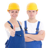 Young man and woman in builder 's uniform isolated on white Stock Photography