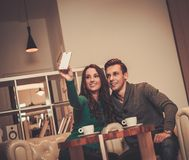Young man and woman in cafe Royalty Free Stock Images