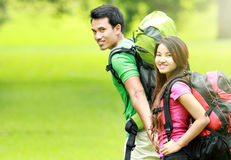 Young man and woman camping in the park Stock Photos