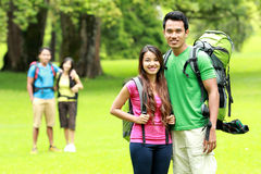 Young man and woman camping in the park Royalty Free Stock Photography