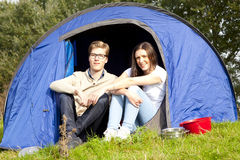 Young man and woman camping with tent Royalty Free Stock Photography