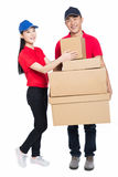 Young man and woman carrying cardboard box Stock Images