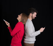 Young man and woman with cellphones Stock Photo