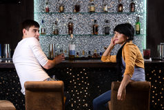 Young man and woman chatting at the bar Stock Photos