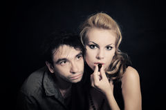 Young man and woman with chocolate candies Royalty Free Stock Photography