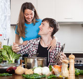 Young man and woman cooking with soup Stock Photos