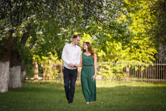 Young man and woman couple in a blooming apple garden Stock Photos