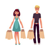 Young man and woman, couple, friends with shopping bags Royalty Free Stock Photo