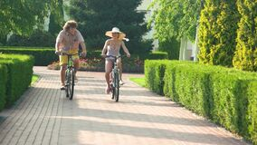 Young man and woman cycling outdoors. stock video footage