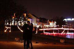 Young loving couple dancing on a night street