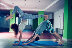 Young man and woman doing acro yoga  indoor Royalty Free Stock Photography