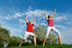 Young man and woman doing stretching exercises Stock Images
