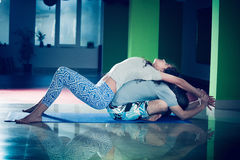 Young man and woman doing yoga  indoor Stock Photography