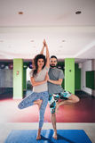Young man and woman doing yoga  indoor Stock Photo