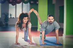 Young man and woman doing yoga  indoor Royalty Free Stock Photos