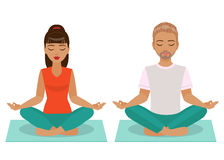 Young Man and Woman Doing Yoga. The young man and woman sitting and meditating in the Yoga Lotus position  on white background Royalty Free Stock Photography