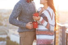 Young man and woman drinking  coffee outdoors Stock Images