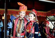 Young man and woman in Dusun Lotud traditional costume. KOTA KINABALU, MALAYSIA - MAY 31, 2016:  Young man and woman in Dusun Lotud traditional costumes during Royalty Free Stock Photography