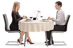 Young man and woman eating on a date Stock Photo