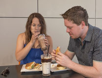 Young Man and Woman Eating Lunch. Stock Image