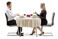 Young man and woman eating salad at a table royalty free stock images