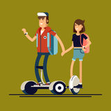 Young man and woman on electric scooter mono wheel Royalty Free Stock Image