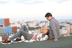 Young man and woman embrace and having fun outdoors Stock Photos