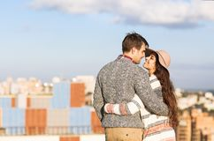 Young man and woman embrace and having fun outdoors Stock Images