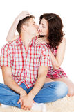 Young man and woman embrace and kiss Stock Images