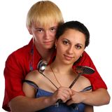 Young man and woman embraces with utensil Royalty Free Stock Images