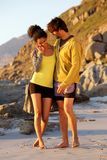 Young man and woman embracing at the beach royalty free stock photo