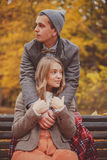 The young man and woman embracing on a bench Royalty Free Stock Images