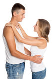 Young man and woman embracing each other Stock Image