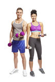 Young man and woman exercising in sports outfits Royalty Free Stock Photography